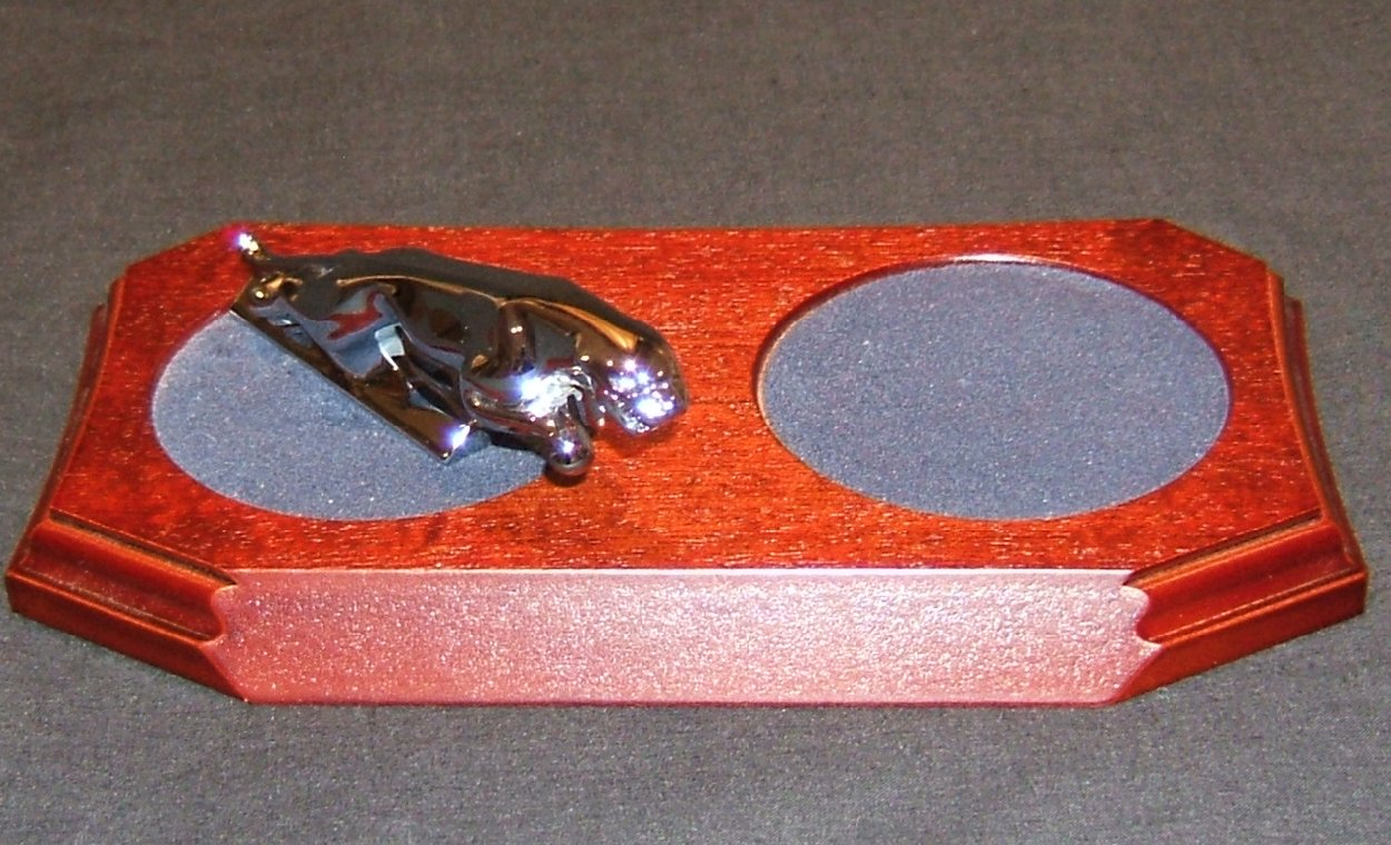 Small Chrome Plated Jaguar Mounted on a wood Plinth with a Recessed Felt Cup/Glass coaster