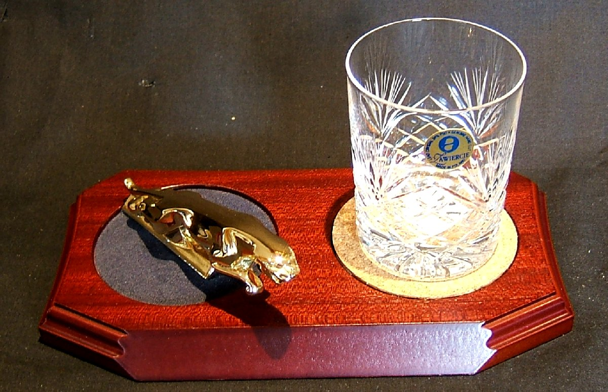 Small Gold Plated Jaguar Mounted on a wood Plinth with One Lead Crystal Whisky Tumbler and Cork Coaster