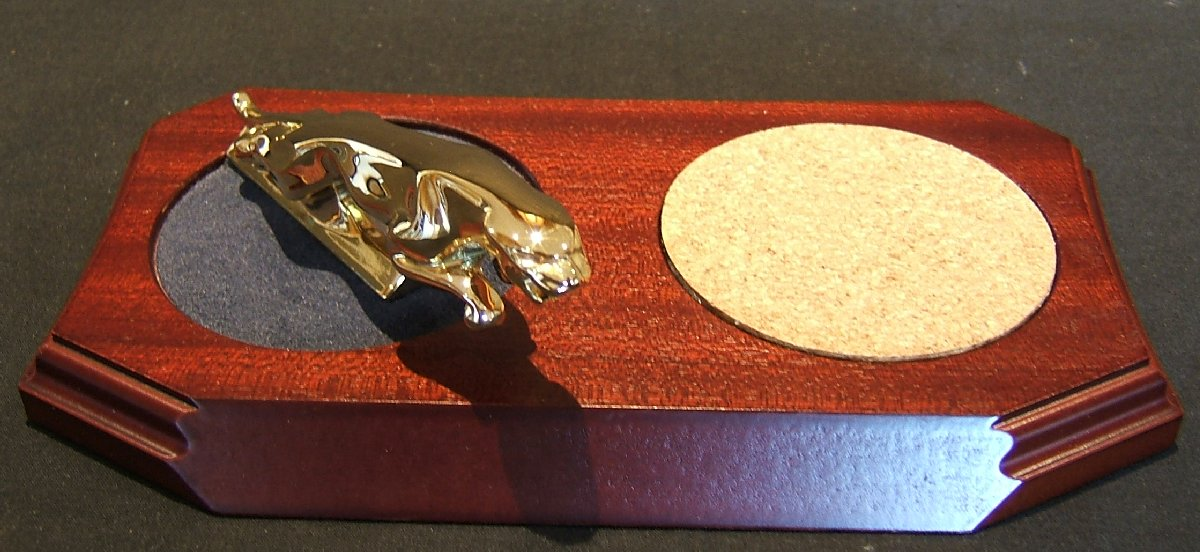 Small Gold Plated Jaguar Mounted on a wood Plinth with a Cork Cup/Glass coaster