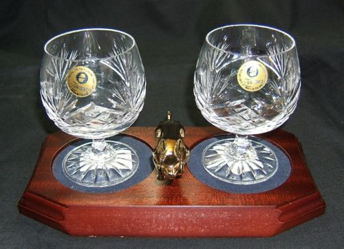 Small Gold Plated Jaguar Mounted on a wood Plinth with Two Lead Crystal Brandy Glasses