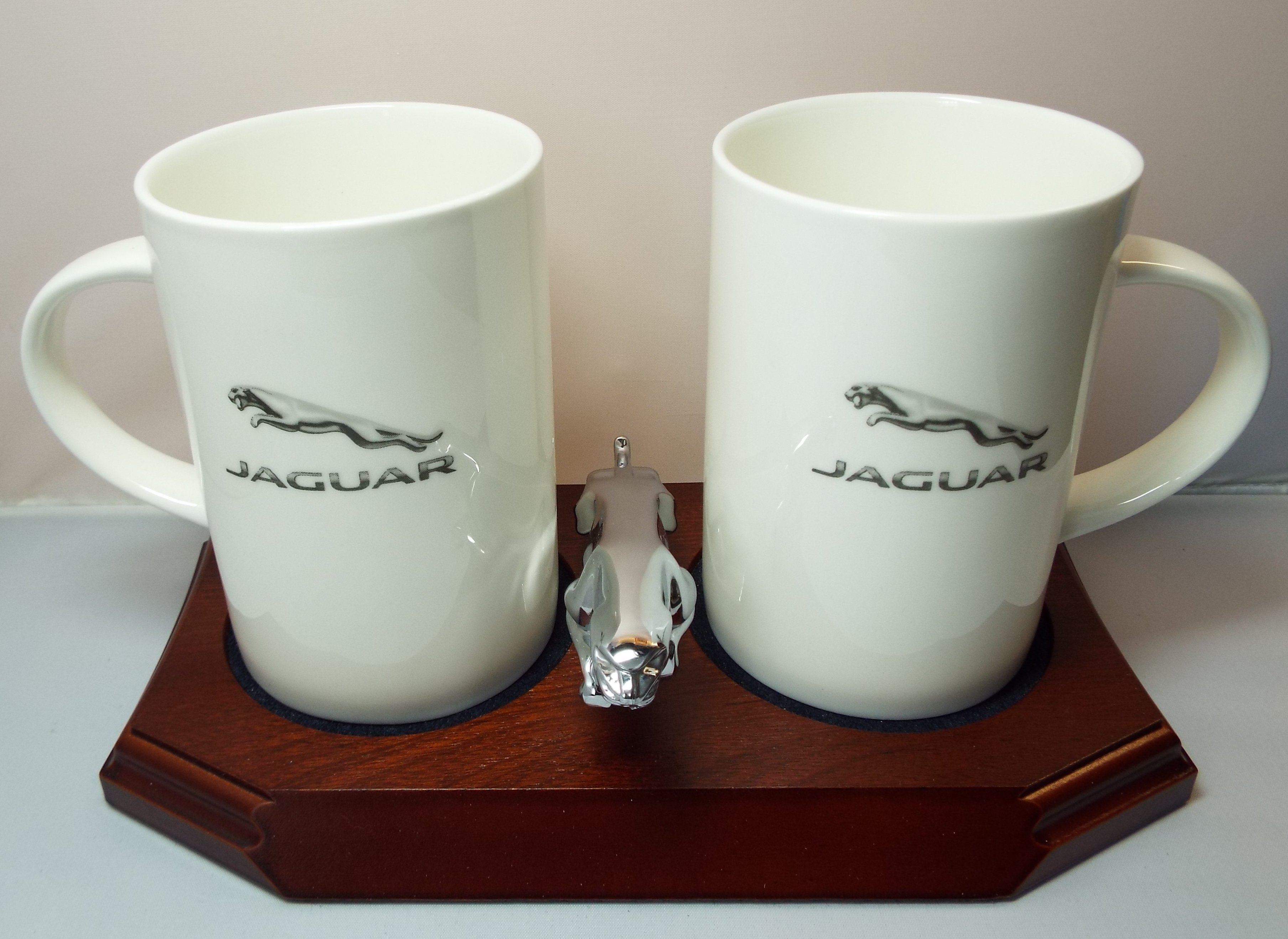 Small Chrome Plated Jaguar Mounted on a wood Plinth with Two Bone China Mugs