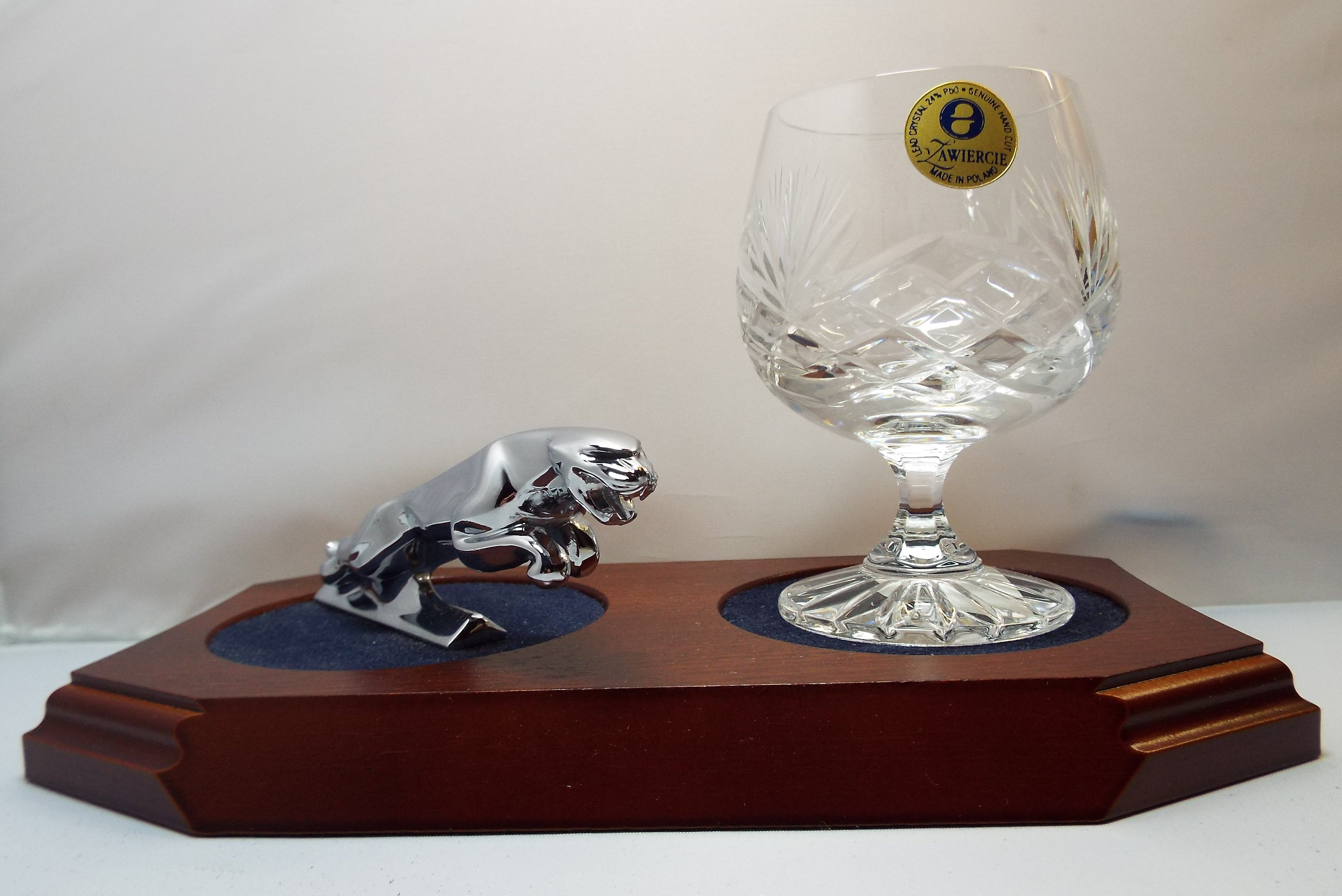 Small Chrome Plated Jaguar Mounted on a wood Plinth with One Lead Crystal Brandy Glass and Felt Coaster
