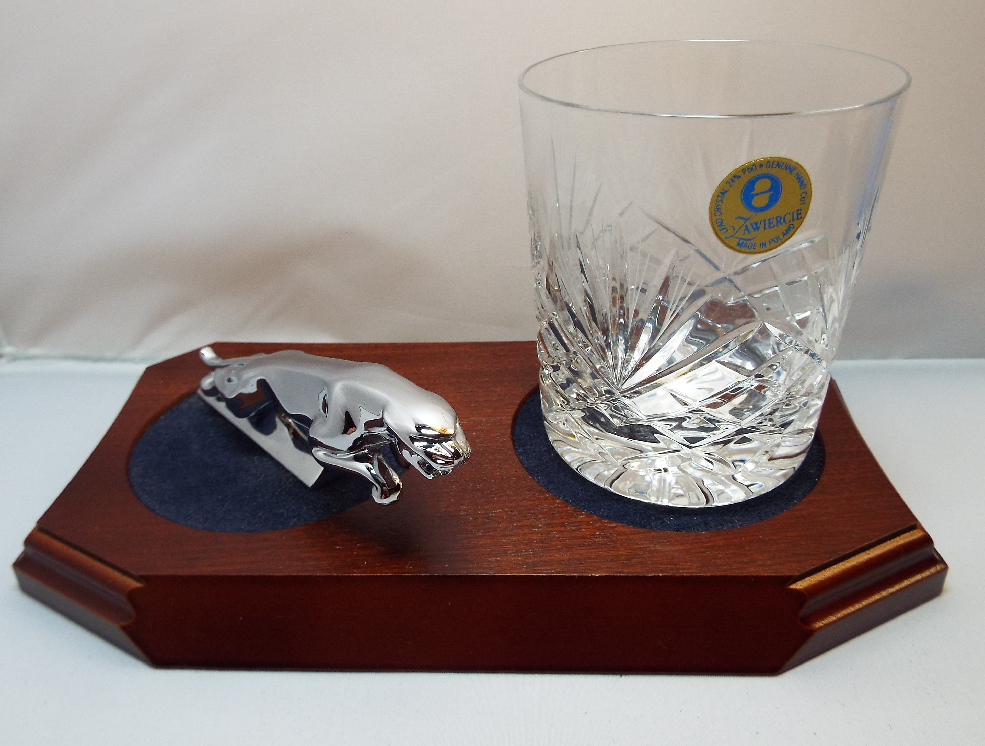 Small Chrome Plated Jaguar Mounted on a wood Plinth with One Lead Crystal Whisky Tumbler and Felt Coaster